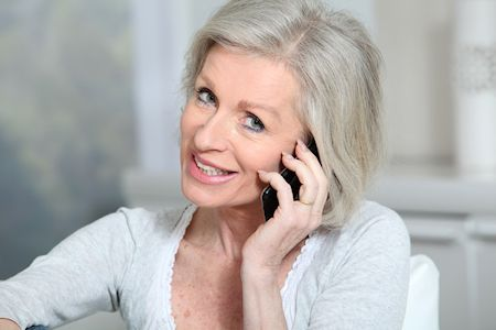 cute older woman on her mobile phone