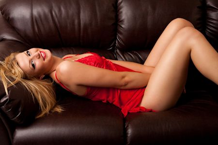 cute cougar laying on a sofa
